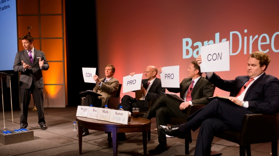 Yup, that's me moderating a point-counterpoint session on bank M&A